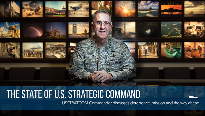 Commander sits at a table with a grid of military images behind him